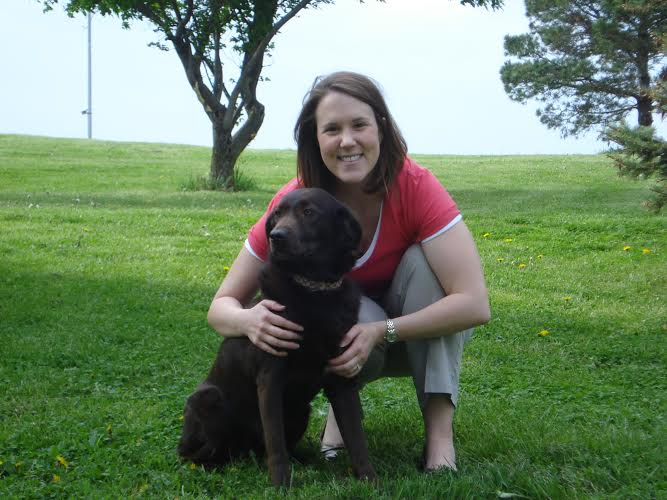 Dr. Michelle Beck DVM with her Chocolate Labrador Dog